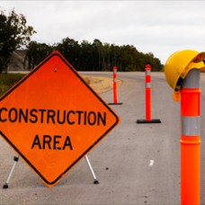 Construction sign that reads 'Construction Area' on the side of a road