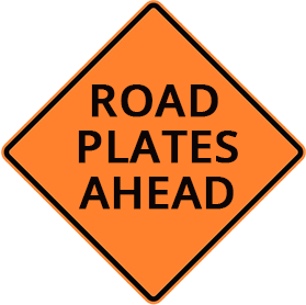 Orange construction sight with the text'road plates ahead